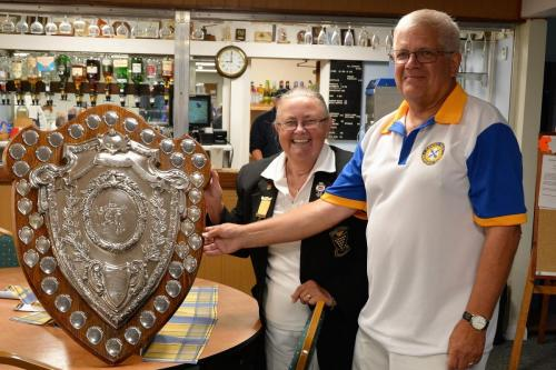 Peter Gilbert presented with winners shield by Jennie Dyer