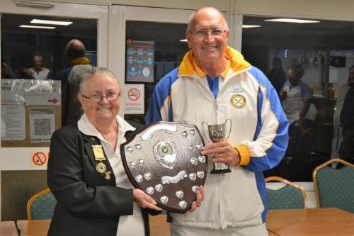 Gary Harrison presented with winners shield by Jennie Dyer